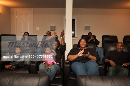 Extended Family Watching Movie in Home Theater Stock Photo - Premium Royalty-Free, Image code: 600-07368552