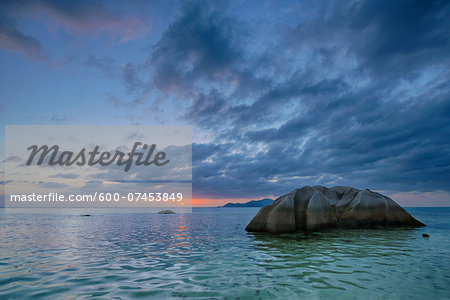 Rocks in Water at Anse Source d´Argent at Sunset, La Digue, Seychelles Stock Photo - Premium Royalty-Free, Image code: 600-07453849