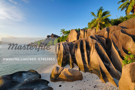 Rock Formations and Palm Trees near Sunset, Anse Source d´Argent, La Digue, Seychelles Stock Photo - Premium Royalty-Free, Image code: 600-07453853