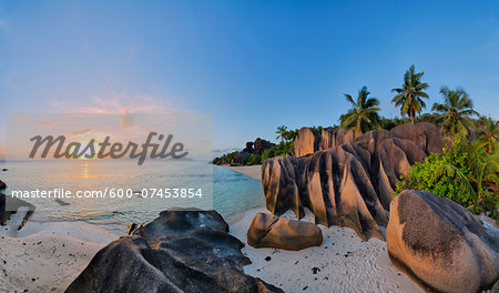 Rock Formations and Palm Trees at Sunset, Anse Source d´Argent, La Digue, Seychelles Stock Photo - Premium Royalty-Free, Image code: 600-07453854