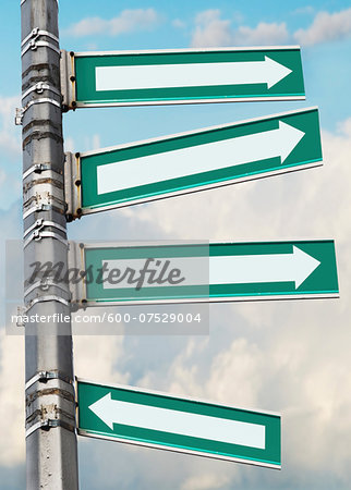 Arrow signs on a pole, showing different directions against sky Stock Photo - Premium Royalty-Free, Image code: 600-07529004