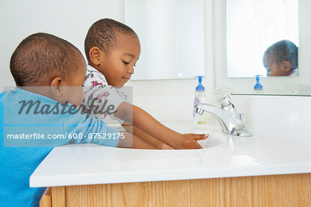 Boys Washing Hands in Bathroom Sink Stock Photo - Premium Royalty-Free, Image code: 600-07529175