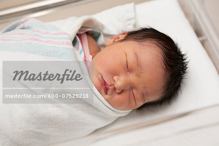 Newborn Baby Girl in Hospital Bassinet Stock Photo - Premium Royalty-Free, Image code: 600-07529218