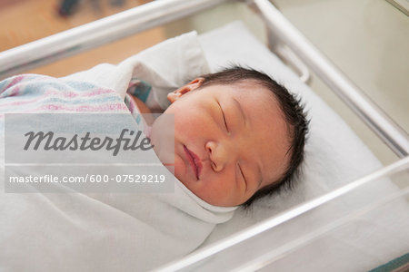 Newborn Baby Girl in Hospital Bassinet Stock Photo - Premium Royalty-Free, Image code: 600-07529219
