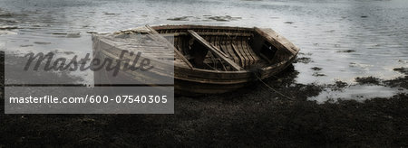 Close-up of decaying fishing boat at low tide, Isle of Skye, Scotland Stock Photo - Premium Royalty-Free, Image code: 600-07540305