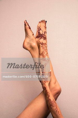 Woman's Legs and Arm Painted with Henna in Arabic Style, Studio Shot Stock Photo - Premium Royalty-Free, Image code: 600-07591300
