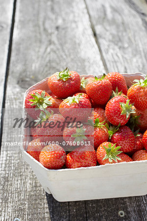 Close-up of freshly picked strawberries in box container on table outdoors, Germany Stock Photo - Premium Royalty-Free, Image code: 600-07600013