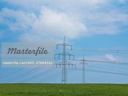 High-voltage transmission towers and field, Weser Hills, North Rhine-Westphalia, Germany Stock Photo - Premium Royalty-Free, Image code: 600-07608332