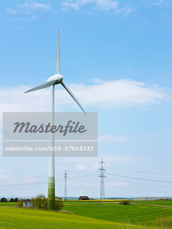 Wind turbine with high-voltage transmission towers in the background, Weser Hills, North Rhine-Westphalia, Germany Stock Photo - Premium Royalty-Free, Image code: 600-07608333