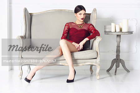 Portrait of Young Woman Sitting on Chair Stock Photo - Premium Royalty-Free, Image code: 600-07672167
