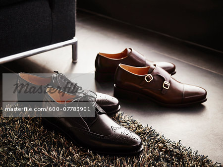 Two pairs of men's dress shoes on the floor, studio shot Stock Photo - Premium Royalty-Free, Image code: 600-07783901