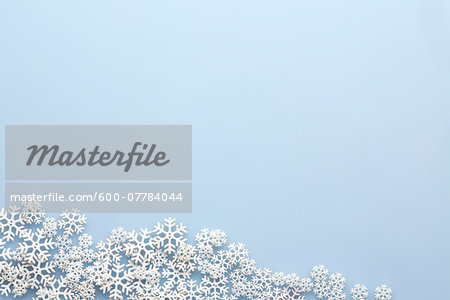 Snowflakes on Blue Background Stock Photo - Premium Royalty-Free, Image code: 600-07784044