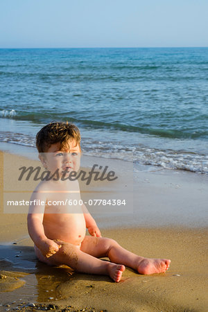 Baby Boy on Sand at Beach Stock Photo - Premium Royalty-Free, Image code: 600-07784384