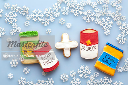 Overhead View of Sugar Cookies Decorated like Food Products on Blue Background with Snowflakes Stock Photo - Premium Royalty-Free, Image code: 600-07784433