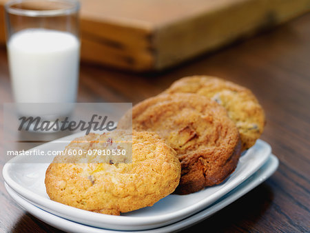 Variety of Cookies on Plate with Glass of Milk Stock Photo - Premium Royalty-Free, Image code: 600-07810530