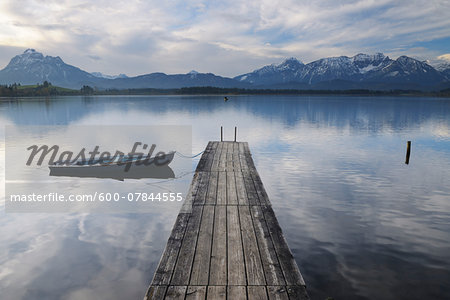 Wooden Jetty with Rowboat, Hopfen am See, Lake Hopfensee, Bavaria, Germany Stock Photo - Premium Royalty-Free, Image code: 600-07844555