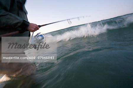 Close-up of man casting for stripers in the surf at Sachuest Beach along the coast of Rhode Island, USA Stock Photo - Premium Royalty-Free, Image code: 600-07945083
