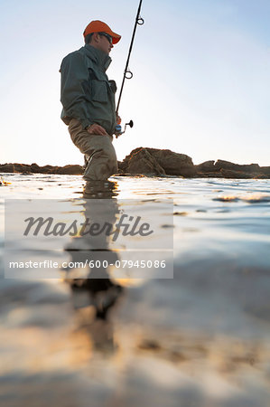 Man fishing along the coast of Rhode Island, USA Stock Photo - Premium Royalty-Free, Image code: 600-07945086