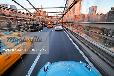 Driving over the Brooklyn Bridge in a VW Beetle towards Manhattan, New York City, New York, USA. Stock Photo - Premium Royalty-Free, Image code: 600-07945136