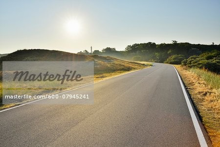 Country Road with Sun in Summer, Norderney, East Frisia Island, North Sea, Lower Saxony, Germany Stock Photo - Premium Royalty-Free, Image code: 600-07945241