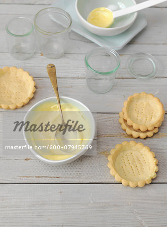 Overhead View of Custard being Mixed in White Bowl with Tarts waiting to be Filled, Studio Shot Stock Photo - Premium Royalty-Free, Image code: 600-07945369