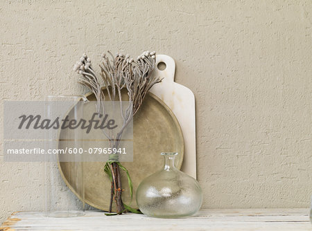 Still life of dried twigs with glass vase, platter and marble board. Stock Photo - Premium Royalty-Free, Image code: 600-07965941