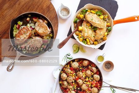Three healthy skillet dinners with pork, meatballs and chicken, studio shot on white background Stock Photo - Premium Royalty-Free, Image code: 600-08002129