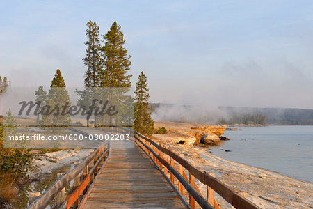 Boardwalk at West Thumb Geyser Basin with Steam from Hot Springs and Yellowstone Lake in the background, Yellowstone National Park, Wyoming, USA Stock Photo - Premium Royalty-Free, Image code: 600-08002203
