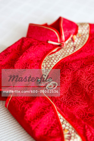 Close-up of a red, cheongsam dress, studio shot on white background Stock Photo - Premium Royalty-Free, Image code: 600-08002536