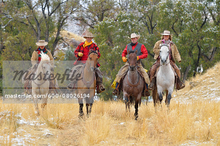 Cowboys and Cowgirls Riding Horses, Rocky Mountains, Wyoming, USA Stock Photo - Premium Royalty-Free, Image code: 600-08026194