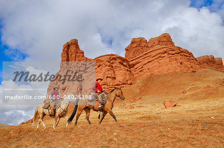 Cowboy and Cowgirl Riding Horses, Wyoming, USA Stock Photo - Premium Royalty-Free, Image code: 600-08026198