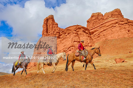 Cowboys and Cowgirl Riding Horses, Wyoming, USA Stock Photo - Premium Royalty-Free, Image code: 600-08026202