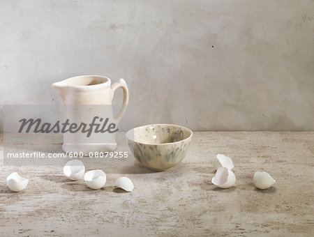 Egg Shells with Pitcher and Bowl, Studio Shot Stock Photo - Premium Royalty-Free, Image code: 600-08079255