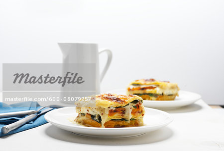 Lasagne on White Plates with Pitcher, Studio Shot Stock Photo - Premium Royalty-Free, Image code: 600-08079257