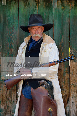 Portrait of Cowboy with Rifle, Shell, Wyoming, USA Stock Photo - Premium Royalty-Free, Image code: 600-08082884