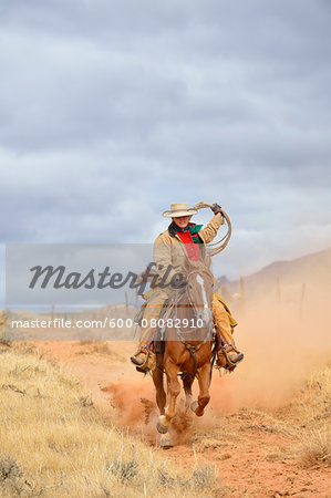 Cowgirl Riding Horse with Rope in Hand, Shell, Wyoming, USA Stock Photo - Premium Royalty-Free, Image code: 600-08082910