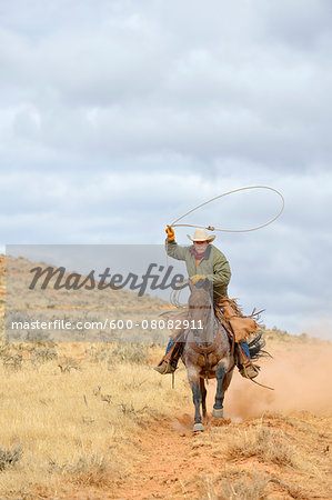 Cowboy Riding Horse with Lasso in Hand, Shell, Wyoming, USA Stock Photo - Premium Royalty-Free, Image code: 600-08082911