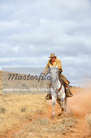 Cowboy Riding Horse with Rope in Hand, Shell, Wyoming, USA Stock Photo - Premium Royalty-Free, Image code: 600-08082912