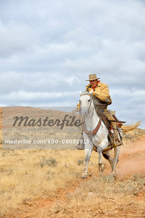Cowboy Riding Horse with Rope in Hand, Shell, Wyoming, USA Stock Photo - Premium Royalty-Free, Image code: 600-08082913