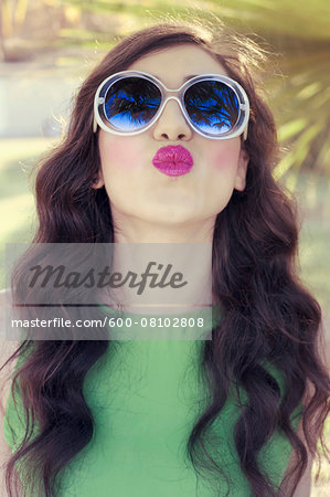 Portrait of Young Woman Blowing Kisses, Italy Stock Photo - Premium Royalty-Free, Image code: 600-08102808