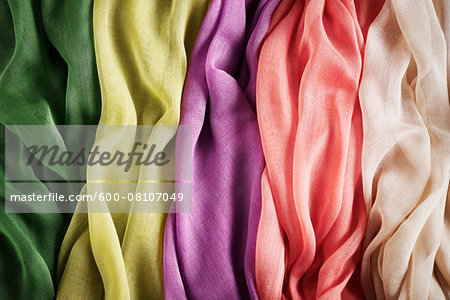 Close-up of five colourful summer scarves, studio shot Stock Photo - Premium Royalty-Free, Image code: 600-08107049