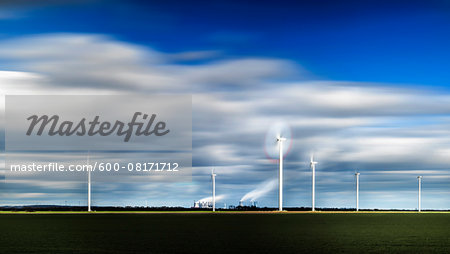 Wind turbines with factory in the background, Germany Stock Photo - Premium Royalty-Free, Image code: 600-08171712