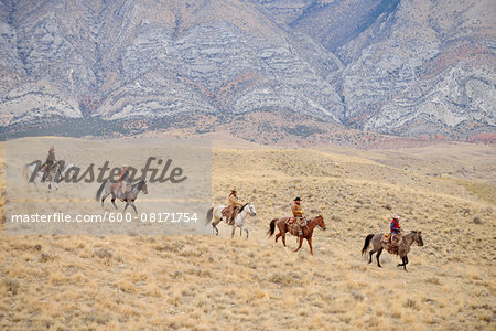 Cowboys and Cowgirls riding horse in wilderness, Rocky Mountains, Wyoming, USA Stock Photo - Premium Royalty-Free, Image code: 600-08171754