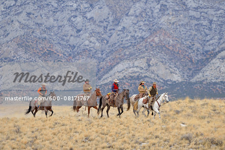 Cowboys and Cowgirls riding horses in wlderness, Rocky Mountains, Wyoming, USA Stock Photo - Premium Royalty-Free, Image code: 600-08171767