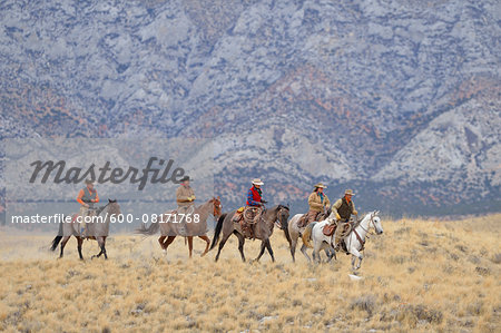 Cowboys and Cowgirls riding horses in wilderness, Rocky Mountains, Wyoming, USA Stock Photo - Premium Royalty-Free, Image code: 600-08171768
