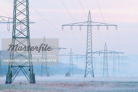 Electricity Pylons in Morning Mist, Hesse, Germany Stock Photo - Premium Royalty-Free, Image code: 600-08548021