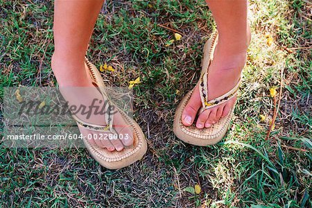 Feet of woman Stock Photo - Premium Royalty-Free, Image code: 604-00228003