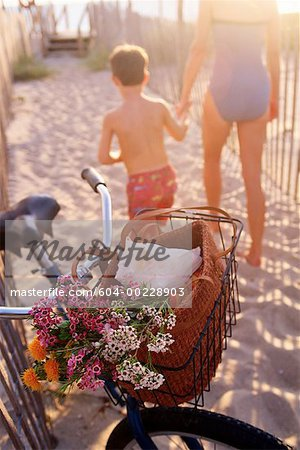 Mother and son with bicycle on beach Stock Photo - Premium Royalty-Free, Image code: 604-00228903