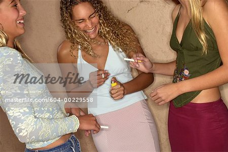 Teenage girls smoking Stock Photo - Premium Royalty-Free, Image code: 604-00229558