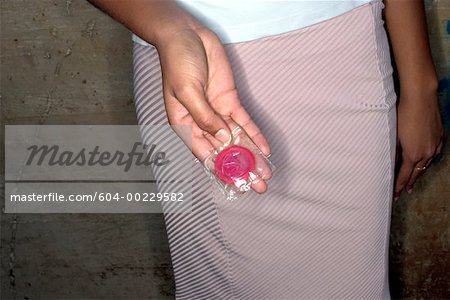Hand holding condom Stock Photo - Premium Royalty-Free, Image code: 604-00229582